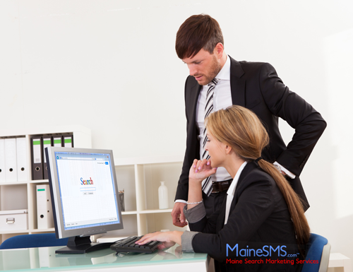 Business man and woman using a computer to search online
